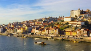 Porto city landscape with rabelo boat sailing through Douro river